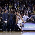 OAKLAND, CA - JANUARY 23:  Stephen Curry #30 reacts after Klay Thompson #11 of the Golden State Warriors made a three-point basket in the third quarter of their game against the Sacramento Kings at ORACLE Arena on January 23, 2015 in Oakland, California. Thompson scored 37 points in the third quarter to set a NBA record. NOTE TO USER: User expressly acknowledges and agrees that, by downloading and or using this photograph, User is consenting to the terms and conditions of the Getty Images License Agreement.  (Photo by Ezra Shaw/Getty Images)