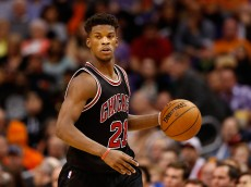 PHOENIX, AZ - JANUARY 30:  Jimmy Butler #21 of the Chicago Bulls handles the ball during the NBA game against the Phoenix Suns at US Airways Center on January 30, 2015 in Phoenix, Arizona. The Suns defeated the Bulls 99-93.  NOTE TO USER: User expressly acknowledges and agrees that, by downloading and or using this photograph, User is consenting to the terms and conditions of the Getty Images License Agreement.  (Photo by Christian Petersen/Getty Images)
