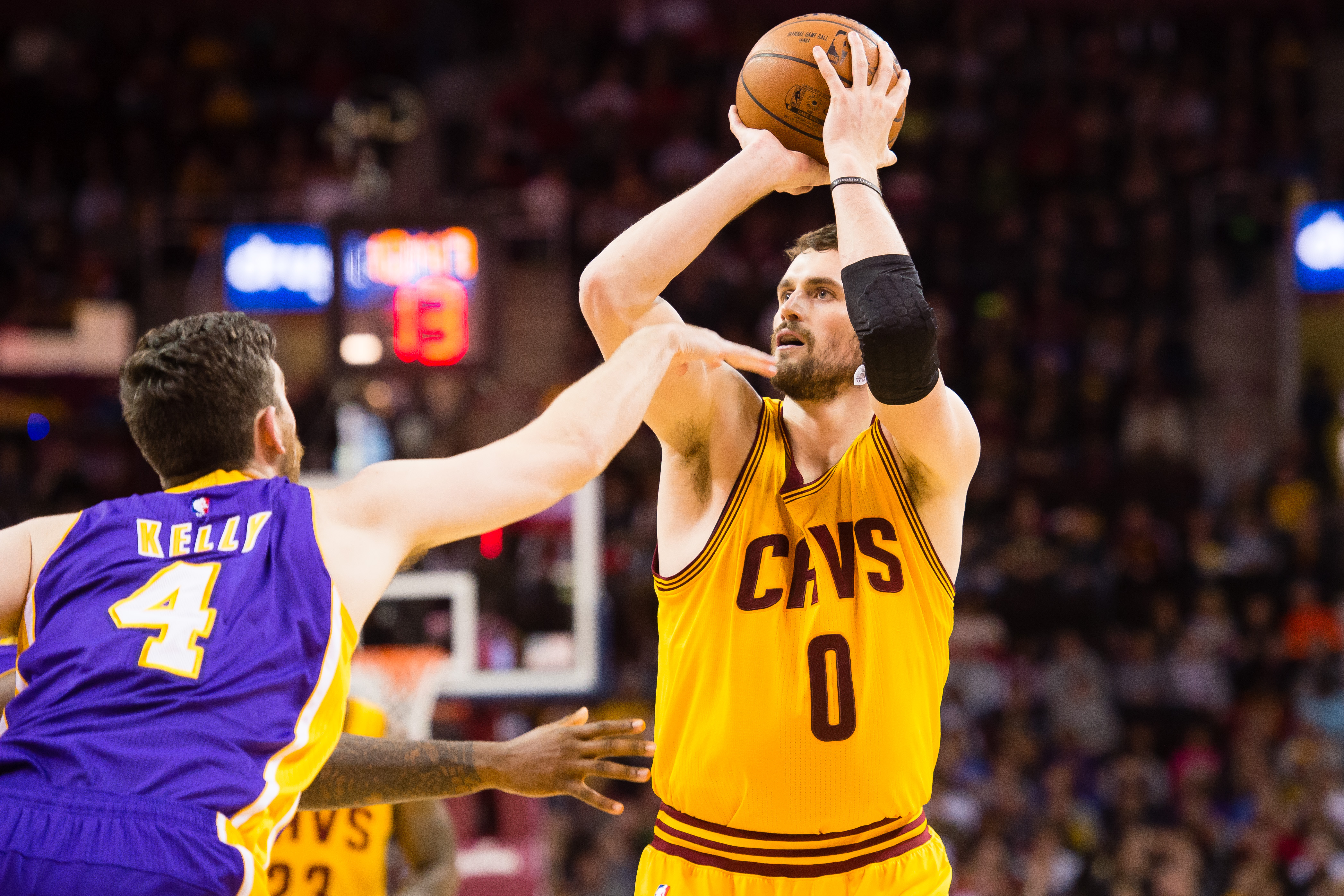 CLEVELAND, OH - FEBRUARY 8: Kevin Love #0 of the Cleveland Cavaliers shots over Ryan Kelly #4 of the Los Angeles Lakers during the first half at Quicken Loans Arena on February 8, 2015 in Cleveland, Ohio. NOTE TO USER: User expressly acknowledges and agrees that, by downloading and or using this photograph, User is consenting to the terms and conditions of the Getty Images License Agreement. (Photo by Jason Miller/Getty Images)  *** Local Caption *** Kevin Love