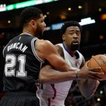 LOS ANGELES, CA - FEBRUARY 19:  DeAndre Jordan #6 of the Los Angeles Clippers is fouled by Tim Duncan #21 of the San Antonio Spurs at Staples Center on February 19, 2015 in Los Angeles, California.  NOTE TO USER: User expressly acknowledges and agrees that, by downloading and or using this Photograph, user is consenting to the terms and condition of the Getty Images License Agreement.  (Photo by Harry How/Getty Images)