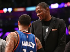 LOS ANGELES, CA - MARCH 01: Injured player Kevin Durant of the Oklahoma City Thunder talks with D.J. Augustin #14 during the game against the Los Angeles Lakers at Staples Center on March 1, 2015 in Los Angeles, California.  The Thunder won 108-101.   NOTE TO USER: User expressly acknowledges and agrees that, by downloading and or using this photograph, User is consenting to the terms and conditions of the Getty Images License Agreement.  (Photo by Stephen Dunn/Getty Images)