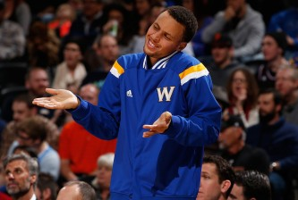 DENVER, CO - MARCH 13:  Stephen Curry #30 of the Golden State Warriors supports his teammates from the bench against the Denver Nuggets at Pepsi Center on March 13, 2015 in Denver, Colorado. NOTE TO USER: User expressly acknowledges and agrees that, by downloading and or using this photograph, User is consenting to the terms and conditions of the Getty Images License Agreement.  (Photo by Doug Pensinger/Getty Images)