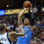 DALLAS, TX - MARCH 16:  Enes Kanter #34 of the Oklahoma City Thunder takes a shot against Tyson Chandler #6 of the Dallas Mavericks at American Airlines Center on March 16, 2015 in Dallas, Texas.  NOTE TO USER: User expressly acknowledges and agrees that, by downloading and or using this photograph, User is consenting to the terms and conditions of the Getty Images License Agreement.  (Photo by Ronald Martinez/Getty Images)