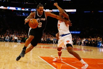 NEW YORK, NY - MARCH 17:  Kawhi Leonard #2 of the San Antonio Spurs in action against Langston Galloway #2 of the New York Knicks during their game at Madison Square Garden on March 17, 2015 in New York City.  NOTE TO USER: User expressly acknowledges and agrees that, by downloading and/or using this photograph, user is consenting to the terms and conditions of the Getty Images License Agreement.  (Photo by Al Bello/Getty Images)