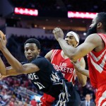 HOUSTON, TX - MARCH 27:  Andrew Wiggins #22 of the Minnesota Timberwolves looks to drive against Corey Brewer #33 and James Harden #13 of the Houston Rockets during their game at the Toyota Center on March 27, 2015 in Houston, Texas. NOTE TO USER: User expressly acknowledges and agrees that, by downloading and/or using this photograph, user is consenting to the terms and conditions of the Getty Images License Agreement.  (Photo by Scott Halleran/Getty Images)