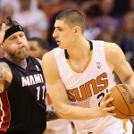 PHOENIX, AZ - FEBRUARY 11:  Alex Len #21 of the Phoenix Suns looks to pass against Chris Andersen #11 of the Miami Heat during the NBA game at US Airways Center on February 11, 2014 in Phoenix, Arizona. The Heat defeated the Suns 103-97.  NOTE TO USER: User expressly acknowledges and agrees that, by downloading and or using this photograph, User is consenting to the terms and conditions of the Getty Images License Agreement.  (Photo by Christian Petersen/Getty Images)