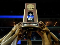 MEMPHIS, TN - MARCH 29:  The Florida Gators celebrate with the trophy after defeating the Dayton Flyers 62-52 in the south regional final of the 2014 NCAA Men's Basketball Tournament at the FedExForum on March 29, 2014 in Memphis, Tennessee.  (Photo by Kevin C. Cox/Getty Images)