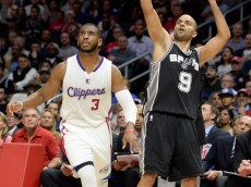 LOS ANGELES, CA - FEBRUARY 19:  Tony Parker #9 of the San Antonio Spurs watches his shot with Chris Paul #3 of the Los Angeles Clippers at Staples Center on February 19, 2015 in Los Angeles, California.  NOTE TO USER: User expressly acknowledges and agrees that, by downloading and or using this Photograph, user is consenting to the terms and condition of the Getty Images License Agreement.  (Photo by Harry How/Getty Images)