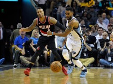 MEMPHIS, TN - APRIL 19:  Damian Lillard #0 of the Portland Trailblazers watches Mike Conley #11 of the Memphis Grizzlies chase a loose ball in the second quarter of Game One of the first round of the 2015 NBA Playoffs at FedExForum on April 19, 2015 in Memphis, Tennessee. NOTE TO USER: User expressly acknowledges and agrees that, by downloading and/or using this photograph, user is consenting to the terms and conditions of the Getty Images License Agreement.(Photo by Frederick Breedon/Getty Images)