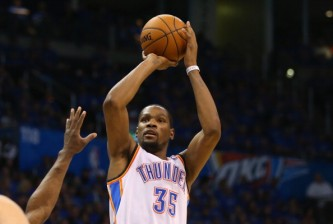 OKLAHOMA CITY, OK - APRIL 19:  Kevin Durant #35 of the Oklahoma City Thunder takes a shot in Game One of the Western Conference Quarterfinals during the 2014 NBA Playoffs at Chesapeake Energy Arena on April 19, 2014 in Oklahoma City, Oklahoma.  NOTE TO USER: User expressly acknowledges and agrees that, by downloading and or using this photograph, User is consenting to the terms and conditions of the Getty Images License Agreement.  (Photo by Ronald Martinez/Getty Images)