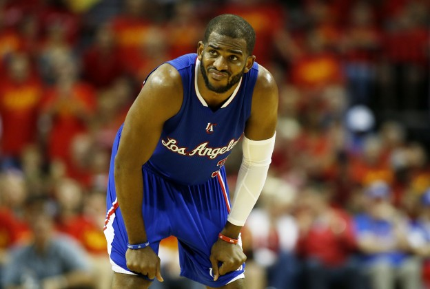 HOUSTON, TX - MAY 17:  Chris Paul #3 of the Los Angeles Clippers reacts in the third quarter against the Houston Rockets during Game Seven of the Western Conference Semifinals at the Toyota Center for the 2015 NBA Playoffs on May 17, 2015 in Houston, Texas. NOTE TO USER: User expressly acknowledges and agrees that, by downloading and/or using this photograph, user is consenting to the terms and conditions of the Getty Images License Agreement.  (Photo by Scott Halleran/Getty Images)
