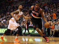 PHOENIX, AZ - NOVEMBER 27:  LaMarcus Aldridge #12 of the Portland Trail Blazers drives the ball against the Phoenix Suns during the NBA game at US Airways Center on November 27, 2013 in Phoenix, Arizona. The Suns defeated the Trail Blazers 120-106.  NOTE TO USER: User expressly acknowledges and agrees that, by downloading and or using this photograph, User is consenting to the terms and conditions of the Getty Images License Agreement.  (Photo by Christian Petersen/Getty Images)