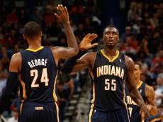 NEW ORLEANS, LA - OCTOBER 30:  Paul George and Roy Hibbert #55 of the Indiana Pacers react after taking the lead against the New Orleans Pelicans at the New Orleans Arena on October 30, 2013 in New Orleans, Louisiana.  NOTE TO USER: User expressly acknowledges and agrees that, by downloading and/or using this photograph, user is consenting to the terms and conditions of the Getty Images License Agreement.  (Photo by Chris Graythen/Getty Images)