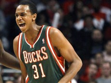 Milwaukee Bucks forward John Henson walks off the court after injuring his left knee during the second half of an NBA preseason basketball game against the Chicago Bulls, Tuesday, Oct. 16, 2012, in Chicago. The Bulls won 100-94. (AP Photo/Charles Rex Arbogast) ORG XMIT: CXA111
