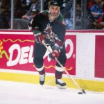 23 Dec 1996:  Defenseman Jim Johnson of the Phoenix Coyotes moves the puck during a game against the Anaheim Mighty Ducks at Arrowhead Pond in Anaheim, California.  The Coyotes won the game, 2-1. Mandatory Credit: Elsa Hasch  /Allsport