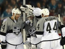 SANTA CLARA, CA - FEBRUARY 21: Dwight King #74, Jonathan Quick #32 and Robyn Regehr #44 of the Los Angeles Kings celebrate their victory over the San Jose Sharks during the 2015 Coors Light NHL Stadium Series game at Levi's Stadium on February 21, 2015 in Santa Clara, California. The Kings defeated the Sharks 2-1.  (Photo by Bruce Bennett/Getty Images)