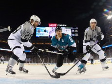SANTA CLARA, CA - FEBRUARY 21: Joe Pavelski #8 of the San Jose Sharks goes up against Jarret Stoll #28 and Justin Williams #14 of the Los Angeles Kings during the 2015 Coors Light NHL Stadium Series game at Levi's Stadium on February 21, 2015 in Santa Clara, California. The Kings defeated the Sharks 2-1.  (Photo by Bruce Bennett/Getty Images)