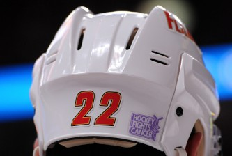 MONTREAL, QC - NOVEMBER 2:  Devin Setoguchi #22 of the Calgary Flames wears the Hockey Fights Cancer logo on his helmet during the NHL game against the Montreal Canadiens at the Bell Centre on November 2, 2014 in Montreal, Quebec, Canada.  The Flames defeated the Canadiens 6-2.  (Photo by Richard Wolowicz/Getty Images)
