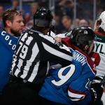 DENVER, CO - FEBRUARY 28:  Linesman Kiel Murchison #79 seperates Jan Hejda #8 of the Colorado Avalanche and Nathan MacKinnon #29 of the Colorado Avalanche from Charlie Coyle #3 of the Minnesota Wild as they scuffle in the first period at Pepsi Center on February 28, 2015 in Denver, Colorado.  (Photo by Doug Pensinger/Getty Images)