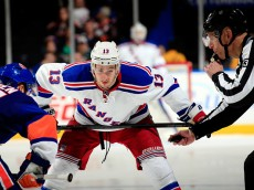 UNIONDALE, NY - MARCH 10: Kevin Hayes #13 of the New York Rangers lines up to faceoff against Frans Nielsen #51 of the New York Islanders during a game at the Nassau Veterans Memorial Coliseum on March 10, 2015 in Uniondale, New York.  (Photo by Alex Trautwig/Getty Images)