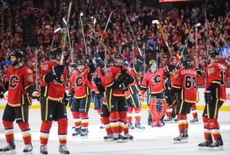 CALGARY, AB - APRIL 9: The Calgary Flames salute the crowd after defeating the Los Angeles Kings during an NHL game at Scotiabank Saddledome on April 9, 2015 in Calgary, Alberta, Canada. The Flames defeated the Kings 3-1. (Photo by Derek Leung/Getty Images)