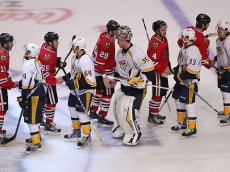 CHICAGO, IL - APRIL 25:  Members of the Chicago Blackhawks and the Nashville Predators shake hands after Game Six of the Western Conference Quarterfinals during the 2015 NHL Stanley Cup Playoffs at the United Center on April 25, 2015 in Chicago, Illinois. The Blackhawks defeated the Predators 4-3 to win the series.  (Photo by Jonathan Daniel/Getty Images)