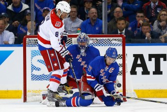 NEW YORK, NY - APRIL 30:  Henrik Lundqvist #30 and Ryan McDonagh #27 of the New York Rangers defend the net against Alex Ovechkin #8 of the Washington Capitals  in Game One of the Eastern Conference Semifinals during the 2015 NHL Stanley Cup Playoffs at Madison Square Garden on April 30, 2015 in New York City.  (Photo by Mike Stobe/Getty Images)