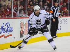 CALGARY, AB - APRIL 9: Justin Williams #14 of the Los Angeles Kings skates against the Calgary Flames during an NHL game at Scotiabank Saddledome on April 9, 2015 in Calgary, Alberta, Canada. The Flames defeated the Kings 3-1. (Photo by Derek Leung/Getty Images)
