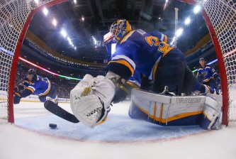 ST. LOUIS, MO - APRIL 18: Jake Allen #34 of the St. Louis Blues makes a save against the Minnesota Wild during Game Two of the Western Conference Quarterfinals during the 2015 NHL Stanley Cup Playoffs at the Scottrade Center on April 18, 2015 in St. Louis, Missouri.  (Photo by Dilip Vishwanat/Getty Images)