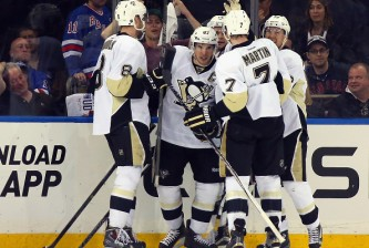 NEW YORK, NY - APRIL 18: The Pittsburgh Penguins celebrate a goal by Sidney Crosby #87 at 18:46 of the second period against the New York Rangers in Game One of the Eastern Conference Quarterfinals during the 2015 NHL Stanley Cup Playoffs at Madison Square Garden on April 18, 2015 in New York City.  (Photo by Bruce Bennett/Getty Images)