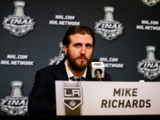 NEW YORK, NY - JUNE 09:  Mike Richards #10 of the Los Angeles Kings speaks to the media at a press conference following Game Three of the 2014 NHL Stanley Cup Final against the New York Rangers at Madison Square Garden on June 9, 2014 in New York, New York.  (Photo by Jim McIsaac/Getty Images)