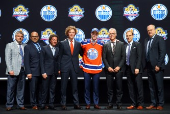 SUNRISE, FL - JUNE 26:  Connor McDavid poses on stage after being selected first overall by the Edmonton Oilers in the first round of the 2015 NHL Draft at BB&T Center on June 26, 2015 in Sunrise, Florida.  (Photo by Bruce Bennett/Getty Images)