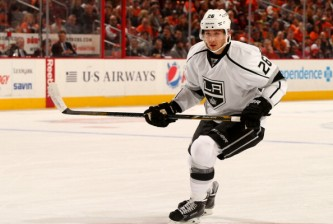 PHILADELPHIA, PA - MARCH 24:  Slava Voynov #26 of the Los Angeles Kings skates against the Philadelphia Flyers at Wells Fargo Center on March 24, 2014 in Philadelphia, Pennsylvania.  (Photo by Elsa/Getty Images)