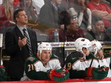 OTTAWA, CANADA - OCTOBER 11: Assistant coach Darryl Sydor of the Minnesota Wild looks up at the jumbotron during a video review in a game against the Ottawa Senators, during the NHL home opener to kick off the Senators' 20th anniversary at Scotiabank Place on October 11, 2011 in Ottawa, Ontario, Canada.  (Photo by Jana Chytilova/Freestyle Photography/Getty Images)