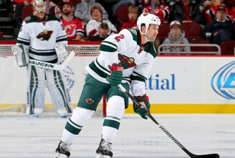 NEWARK, NJ - NOVEMBER 11:  Keith Ballard #2 of the Minnesota Wild takes the puck in the third period against the New Jersey Devils on November 11, 2014 at the Prudential Center in Newark, New Jersey.The New Jersey Devils defeated the Minnesota Wild 3-1.  (Photo by Elsa/Getty Images)