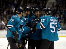 SAN JOSE, CA - DECEMBER 09:  (L-R) Patrick Marleau #12, Brent Burns #88, Scott Hannan #27, Logan Couture #39, and Tommy Wingels #57 of the San Jose Sharks celebrate after Logan Couture scored a goal against the Edmonton Oilers at SAP Center on December 9, 2014 in San Jose, California.  (Photo by Ezra Shaw/Getty Images)