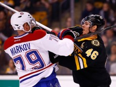 BOSTON, MA - MARCH 24: David Krejci #46 of the Boston Bruins shoves Andrei Markov #79 of the Montreal Canadiens in the first period during the game at TD Garden on March 24, 2014 in Boston, Massachusetts.  (Photo by Jared Wickerham/Getty Images)
