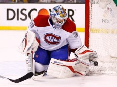 BOSTON, MA - MARCH 24: Peter Budaj #30 of the Montreal Canadiens makes a save against the Boston Bruins in the third period during the game at TD Garden on March 24, 2014 in Boston, Massachusetts.  (Photo by Jared Wickerham/Getty Images)