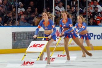 UNIONDALE, NY - NOVEMBER 22: The New York Islanders ice girls handle cleaning the ice during the game against the Pittsburgh Penguins at the Nassau Veterans Memorial Coliseum on November 22, 2014 in Uniondale, New York. The Islanders defeated the Penguins 4-1.  (Photo by Bruce Bennett/Getty Images)