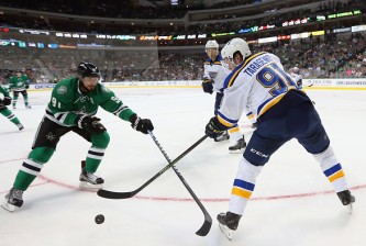 DALLAS, TX - SEPTEMBER 29:  Vladimir Tarasenko #91 of the St. Louis Blues skates the puck against Tyler Seguin #91 of the Dallas Stars during a preseason game at American Airlines Center on September 29, 2015 in Dallas, Texas.  (Photo by Ronald Martinez/Getty Images)