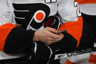 OTTAWA, ON - JANUARY 28:  Matt Read #24 of the Philadelphia Flyers and team Alfredsson tweets with his celephone during the 2012 Molson Canadian NHL All-Star Skills Competition at Scotiabank Place on January 28, 2012 in Ottawa, Ontario, Canada.  (Photo by Bruce Bennett/Getty Images)
