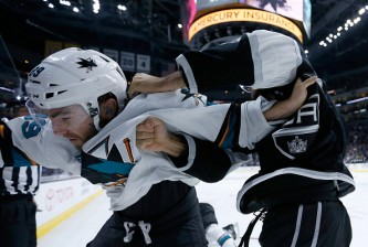 LOS ANGELES, CA - OCTOBER 07:  Barclay Goodrow #89 of the San Jose Sharks and Andy Andreoff #15 of the Los Angeles Kings fight during the third period of a game  at Staples Center on October 7, 2015 in Los Angeles, California.  (Photo by Sean M. Haffey/Getty Images)