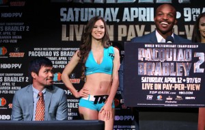Timothy Bradley, standing at right, Manny Pacquiao, sitting