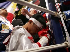 LAS VEGAS - JANUARY 21:  Manny Pacquiao of the Phillippines prays before his fight against Erik Morales of Mexico in the Super Featherweight Championship fight at Thomas & Mack Arena on January 21, 2006 in Las Vegas, Nevada.  Pacquiao defeated Morales by a 10th round knockout.  (Photo by Jed Jacobsohn/Getty Images)