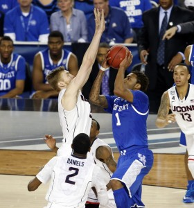 When Niels Giffey stopped this drive by Kentucky's James Young just before the 3:10 mark in regulation with Connecticut leading, 56-52, the Huskies surmounted the last tall obstacle they faced on the road to a fourth national title.
