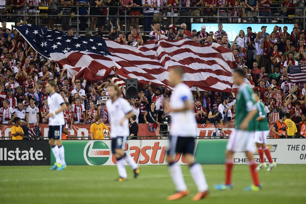 COLUMBUS, OH - SEPTEMBER 10: Fans unfurl a large U.S. flag after the U.S. Men's National Team scored their second goal against Mexico in the second half at Columbus Crew Stadium on September 10, 2013 in Columbus, Ohio. The United States defeated Mexico 2-0. (Photo by Jamie Sabau/Getty Images)
