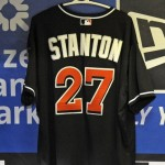 Giancarlo Stanton's jersey hangs in the Marlins dugout