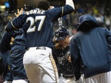 Lyle Overbay and the Milwaukee Brewers celebrate their walk off win