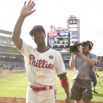 PHILADELPHIA, PA - JUNE 14: Shortstop Jimmy Rollins #11 of the Philadelphia Phillies walks of the field after the Phillies defeated the Chicago Cubs on June 14, 2014 at Citizens Bank Park in Philadelphia, Pennsylvania. (Photo by Mitchell Leff/Getty Images)