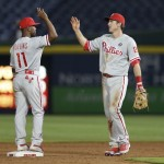 ATLANTA, GA - JUNE 16:  Shortstop Jimmy Rollins #11 of the Philadelphia Phillies celebrates with second baseman Chase Utley #26 after the game against the Atlanta Braves at Turner Field on June 16, 2014 in Atlanta, Georgia.  (Photo by Mike Zarrilli/Getty Images)